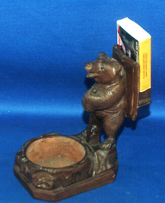 A well carved antique Victorian Black Forest bear figure, match slip holder, pin