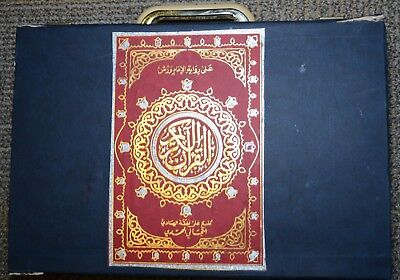 Islam Holy Book (Quran) antique multiple chapters in a case.