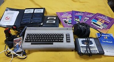 Commodore 64 keyboard controllers tapes tapedeck programming books games power