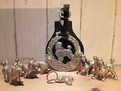 Collection of antique and vintage 'poodle' brass ornaments
