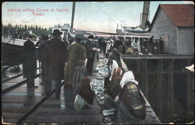 Indians Selling Curios at Yakital, Yukon ~ Div-back postcard used, posted 1929.