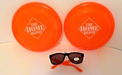 Home Depot Sunglasses 1 Pair And Two Orange Frisbee Frisbies THD