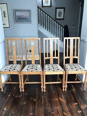 A Set Of 4 Oak Arts And Crafts Chairs