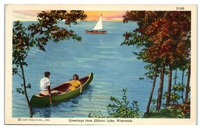 Mid-1900s Greetings from Elkhart Lake, WI Young Couple in a Canoe Postcard