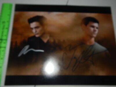 Twilight New Moon Signed Poster by Pattinson and Lautner 11x14