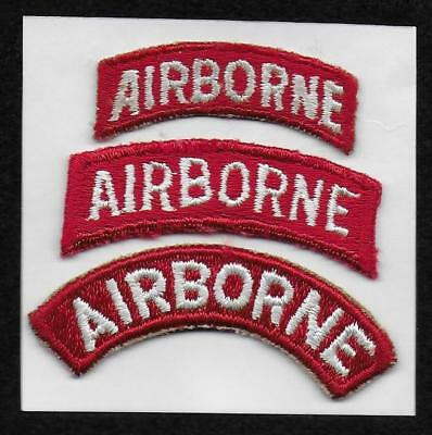 These are three variations of U.S. Army AIRBORNE Tabs, White letters on Red