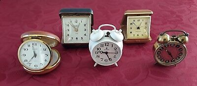 Collection of five vintage wind-up clocks for repair or parts