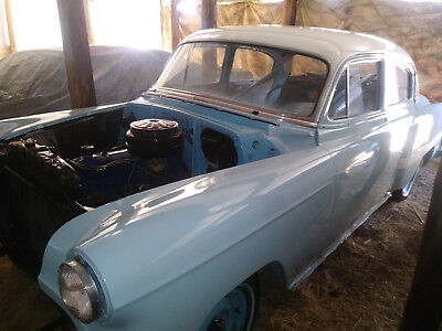 1953 Chevrolet Bel Air/150/210 4 door 1953 chevrolet bel air 4 door light blue and white, new paint, too much to list