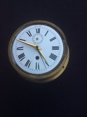 Heavy vintage brass ship's clock fitted with replacement battery movement