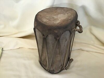 """Lot# 942. Vintage African wood and leather Conga drum. 10"""" tall x 7"""" wide"""
