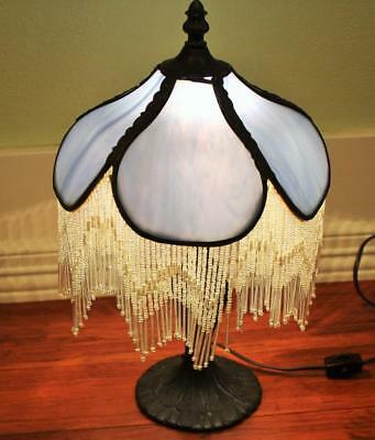 Magificent Stained Glass Table Lamp With Tassels. Quite old. Works great. Offers