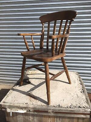 Set of 16 Solid pine stick back dining chairs with curved backs & turned legs