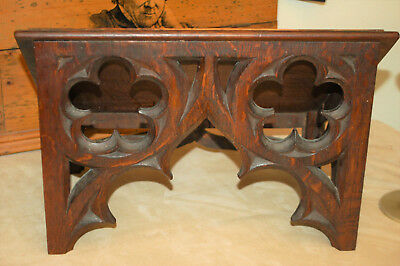 A heavy antique gothic carved tracery oak church bookstand or lecturn