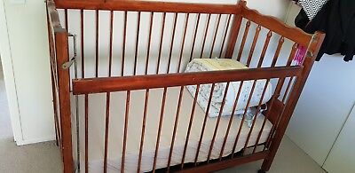 Baby cot with mattress and free bedsheets