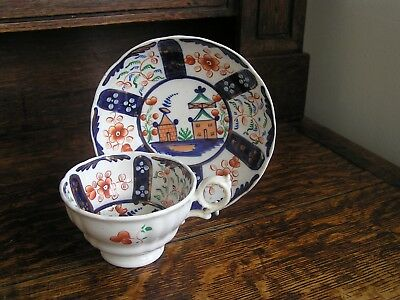 Gaudy Welsh 19th century Village pattern cup and saucer (A/F)