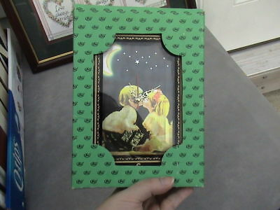 "boy girl kissing in night""glittery lenticular"" gold and marble look frame  table"