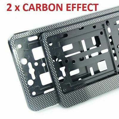 """2 x """"CARBON"""" EFFECT NUMBER PLATE HOLDER SURROUND CAR"""
