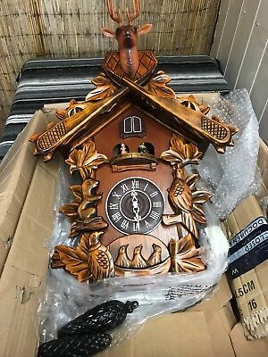 Large Carved Wood Cuckoo Wall Clock With Music & Dancing Carousel.