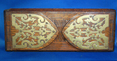 A Victorian gothic church arch ended oak bookslide with brass detail
