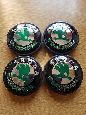 4x SKODA WHEEL CENTRE CAPS 56MM BLACK & GREEN HUB EMBLEM