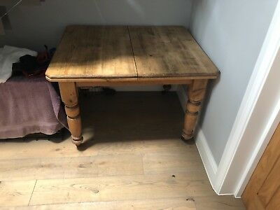 Victorian pine table with leaf insert & caster feet