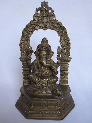 An old look solid brass statue of a GANESHA lucky elephant god hindu tradition.