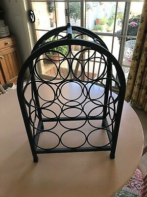 Small wine rack, hold 11 bottles, very decorative in wrought iron.