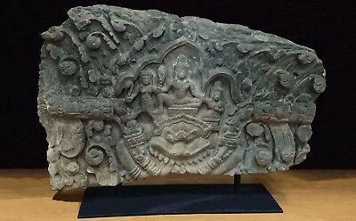 RARE KHMER RELIEF LINTEL FRAGMENT 'VISHVAKARMA' SEATED ATOP KALA, ANGKOR 12th C.