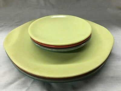 Set of 4 Russel Wright plates and saucers