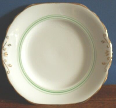 A vintage New Chelsea bone china Cake plate stand in green and gold