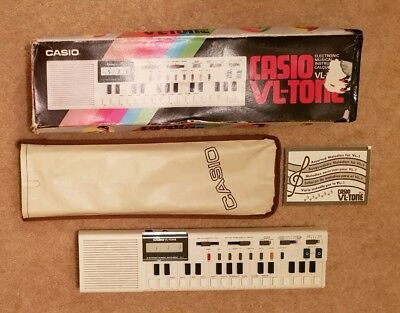Retro Casio VL - Tone VL 1 Mini Keyboard - Boxed with Case and Booklet.