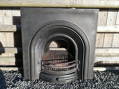 Victorian style cast iron fireplace insert with grate and ash pan