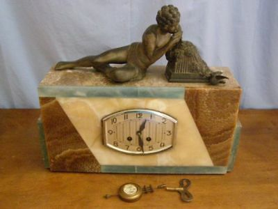 Ancient marble clock, character and bronze object