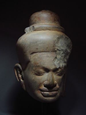 HARDSTONE HEAD OF A MALE DIVINITY, KHMER ANGKOR WAT 'BAPHUON' STYLE 11/12th C.