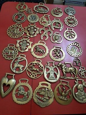 A collection of 31 solid brass antique / vintage horse brasses , job lot,
