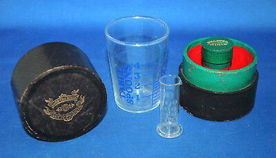 An antique Victorian era cased medicine glass and minim measure
