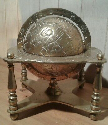 A large antique brass terrestrial globe with astronomy and planetary details