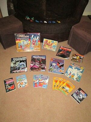 Joblot/Bundle of over 20 TRANSFORMERS related Toys/Books/Comics