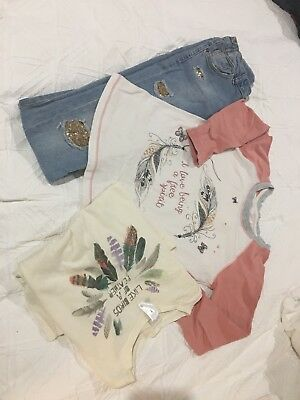 Three items of girls jeans and two tops size 7 to 8 great condition