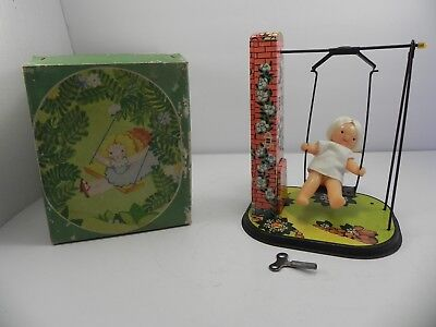 Vintage 1960s USSR Soviet Union Russia Wind Up Tin Toy Girl on Swing with Box