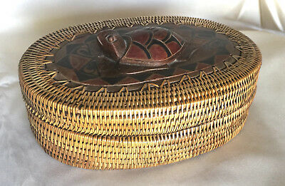 TURTLE BASKET:  Woven grass container with carved and painted wooden lid