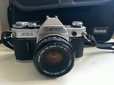 Canon AE-1 Progra 35mm SLR Film Camera with numerous accessories