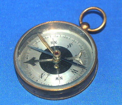 An attractive antique large Victorian or Edwardian brass locking pocket compass