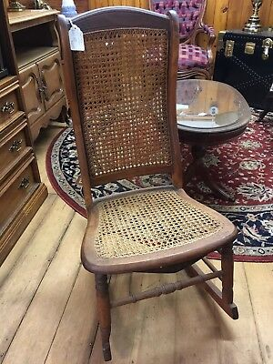 Antique Cane Nursing Rocker - Hand Carved Wood.