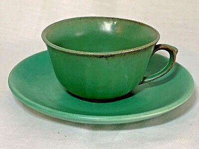 Matte green Catalina Island Pottery cup and saucer set