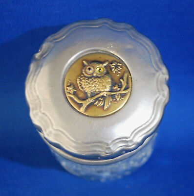 A characterful Victorian white metal and brass repousse owl glass trinket pot