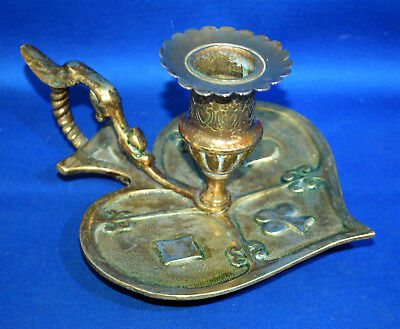 A rare Victorian brass or bronze playing card and dragon chamber candlestick