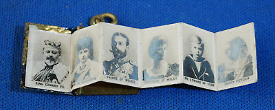 An attractive Edwardian four generation enamelled Royal Family photo book charm
