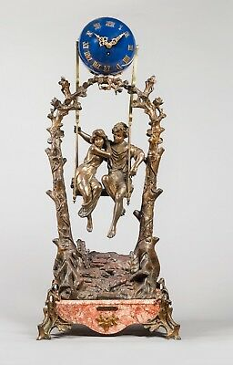 A French gilt patinated metal and marble 'Girl in a swing' Idylle Printanière cl