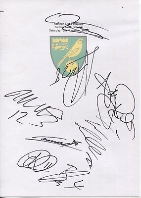 2 A4 white cards with Norwich City badge Signed by 11 players on 10.11.2018
